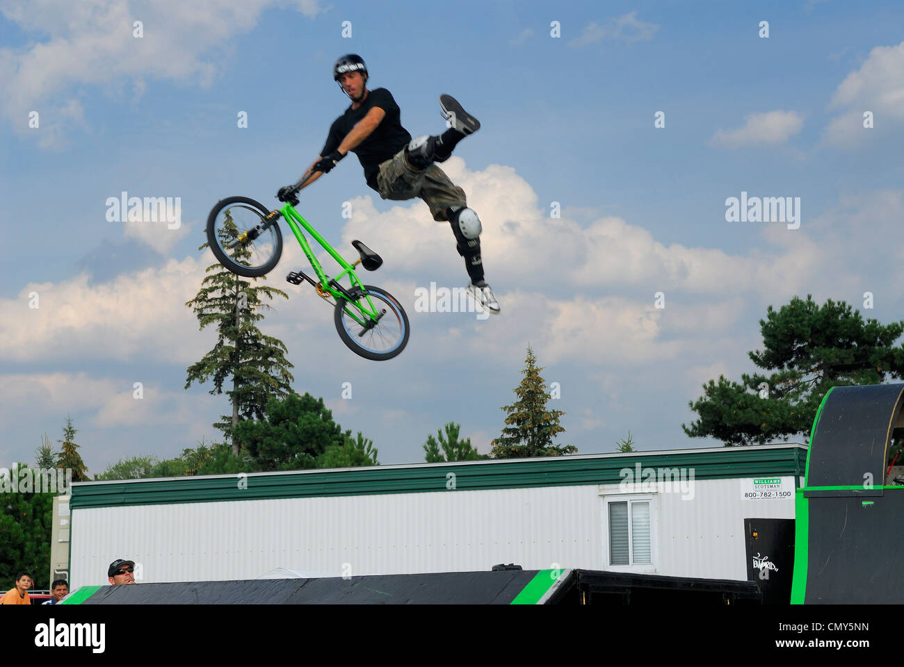 Extreme Stunt rider flying high in the air at the SuperEX in Ottawa - Stock Image