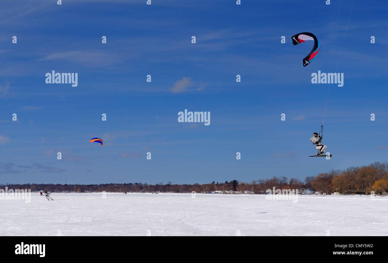 Skier airborne snow kiting on frozen Lake Simcoe Ontario Canada - Stock Image