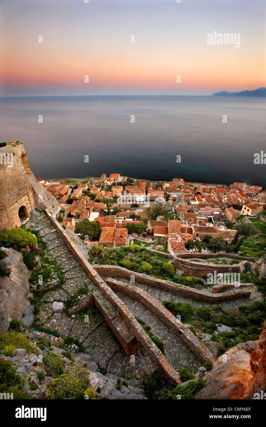 The medieval 'castletown' of Monemvasia (or 'Malvasia') around sunset. Lakonia Prefecture, Peloponnese, - Stock Image