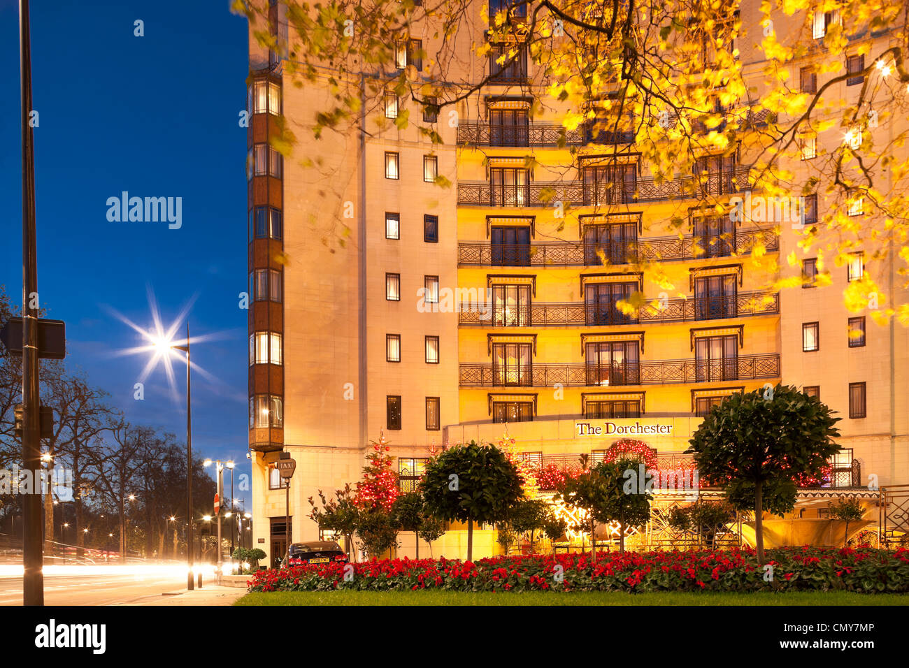 The Dorchester Hotel Park Lane London with Christmas decorations at dusk. Five star luxury hotel facade at night. - Stock Image