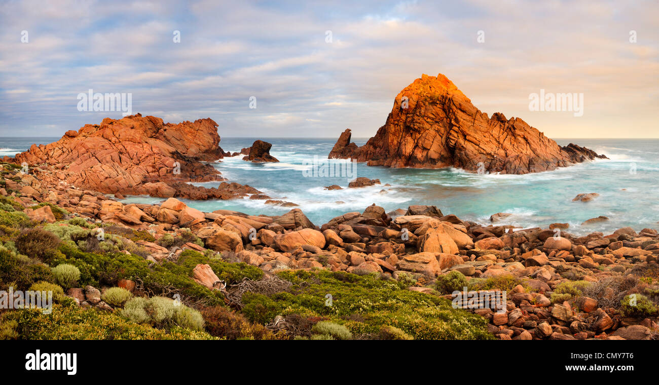 Sunrise at Sugarloaf Rock at Cape Naturaliste in the Leeuwin-Naturaliste National Park. Near Dunsborough, Western - Stock Image