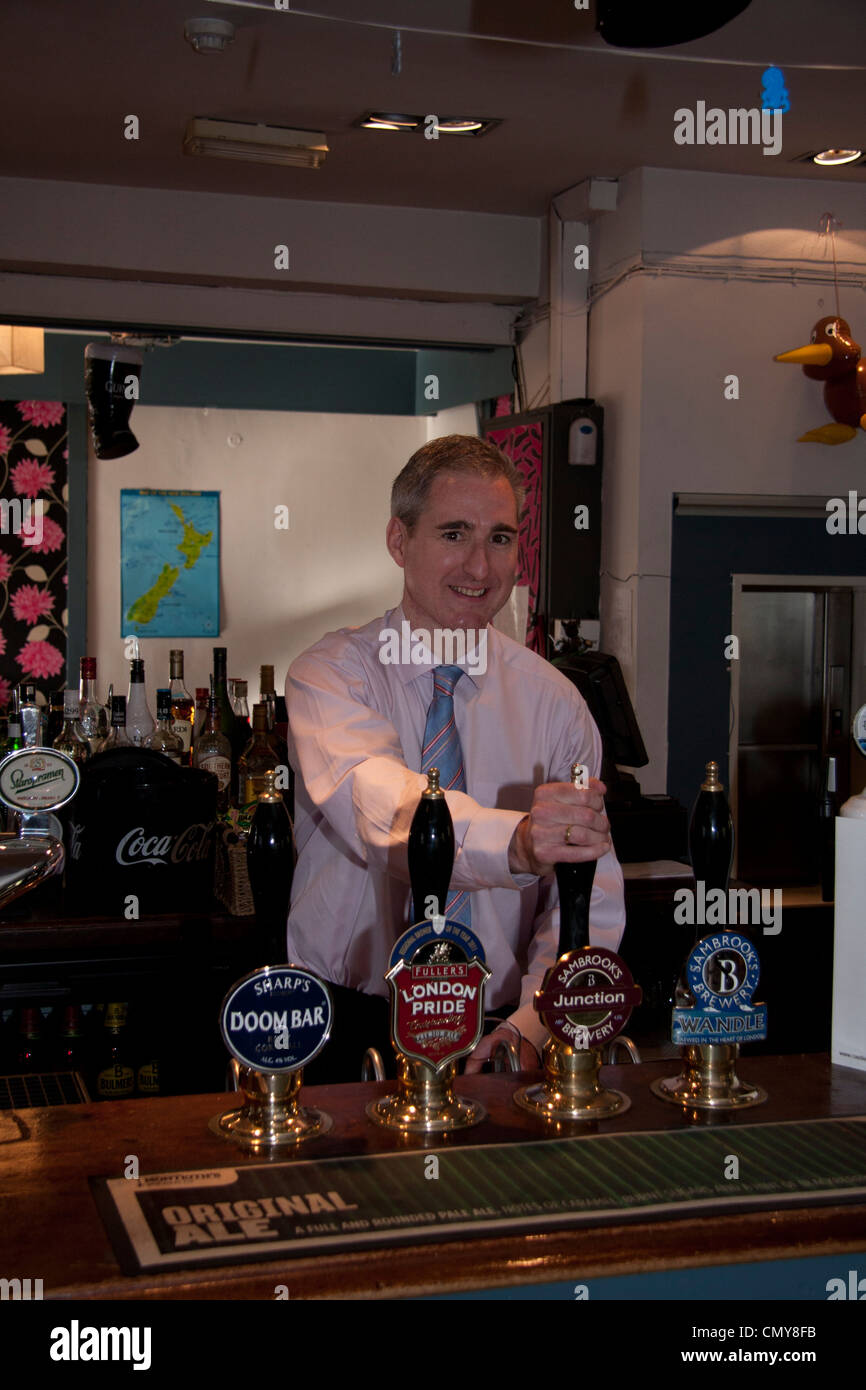 Greg Mullholland MP , pulling a pint of local beer Stock Photo