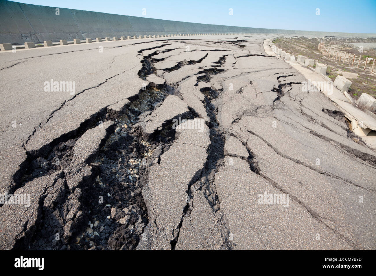 cracked road after earthquake - Stock Image