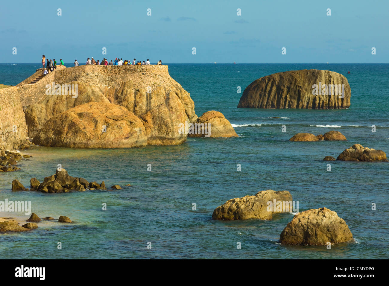 Sightseers gather for sunset on Flag Rock, one of the former Portuguese bastions at the old Dutch Fort; Galle, Sri - Stock Image