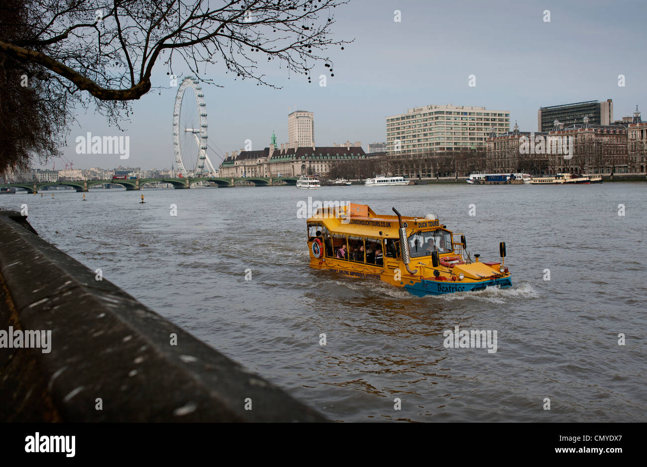 Duck Tours on the River Thames passing the Houses of Parliament and the London Eye, Westminster, London, England. - Stock Image