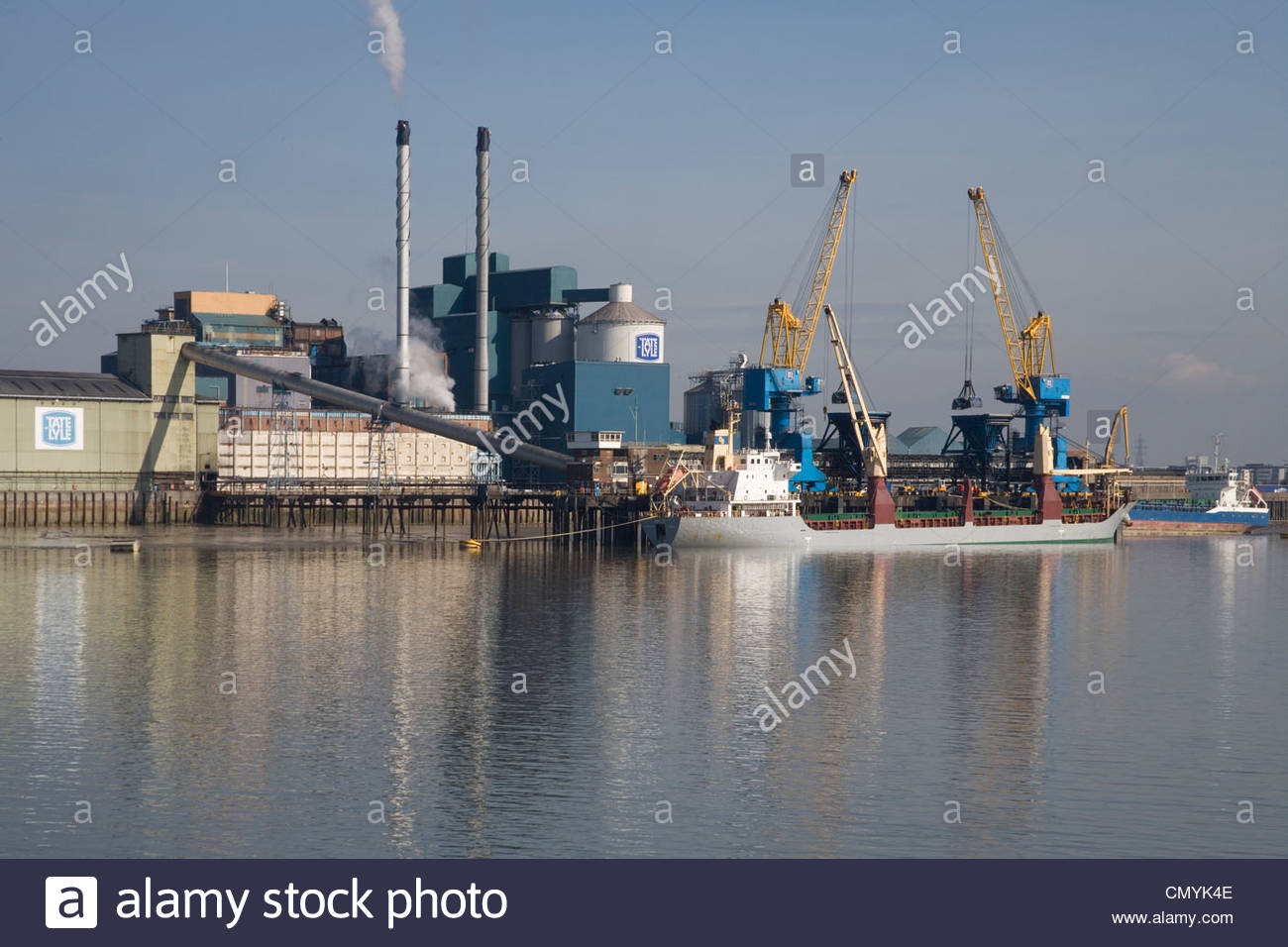 the tate and lyle sugar factory at silvertown on the river thames london - Stock Image