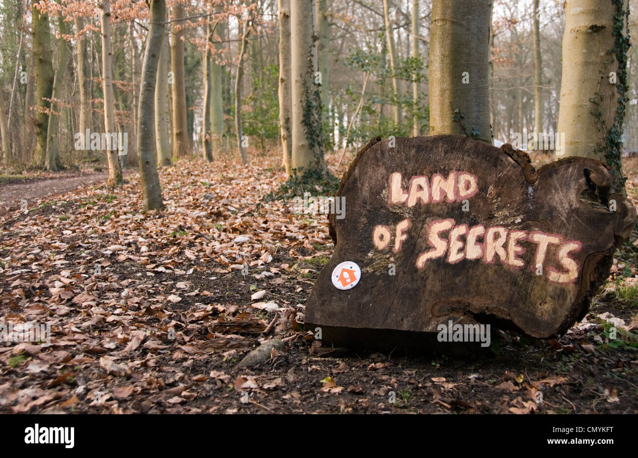 Land of Secrets - woodland footpath sign - with an air of mystery and youthful excitement - adventure. - Stock Image
