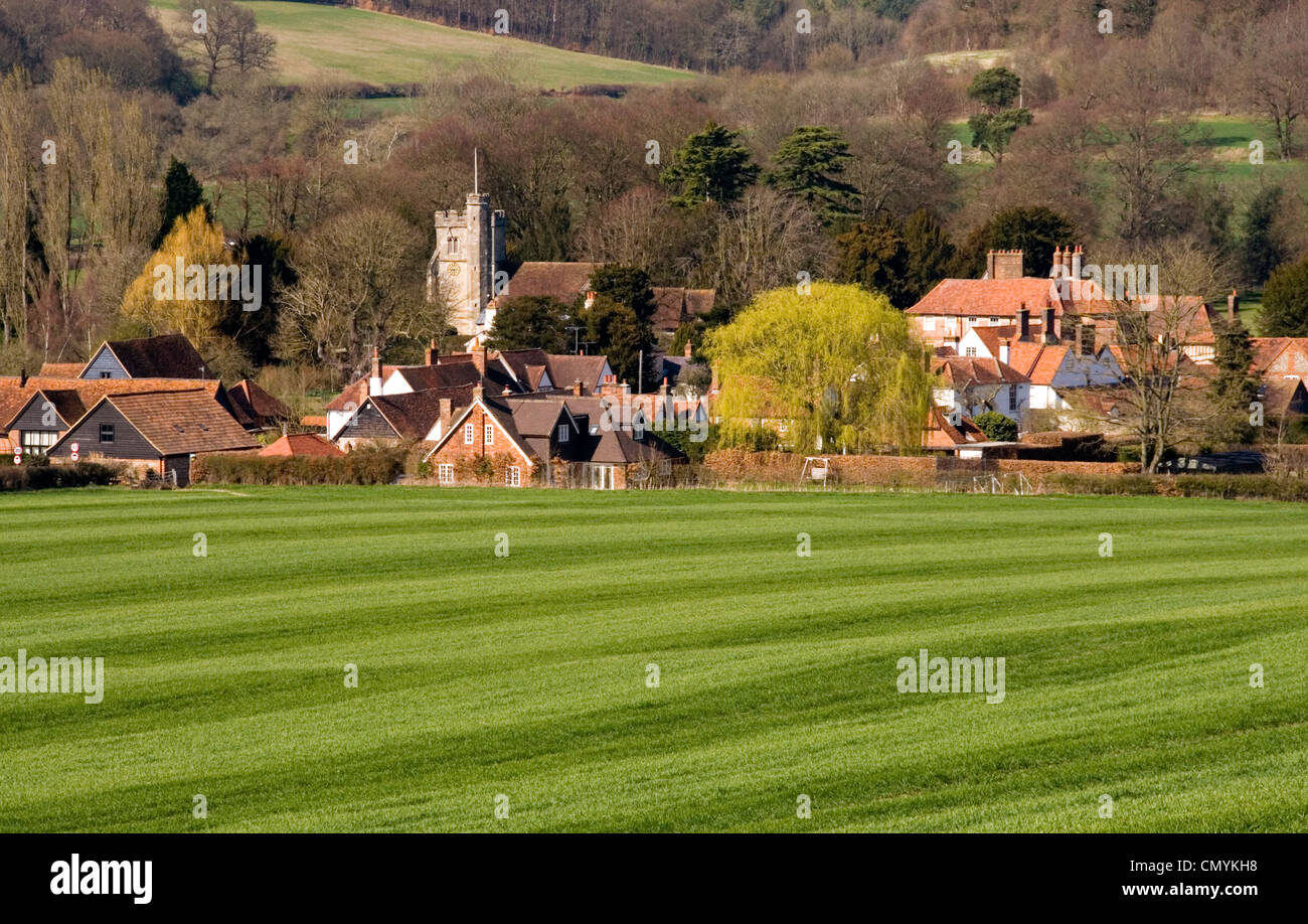 Chiltern Hills - view to Little Missenden village - across field of spring wheat - marked like fresh cut lawn - - Stock Image
