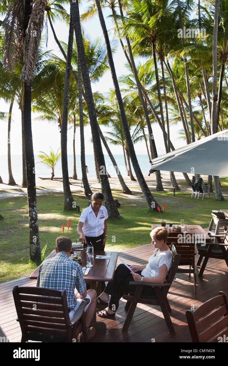 Beachfront dining at Far Horizons Restaurant. Palm Cove, Cairns, Queensland, Australia - Stock Image