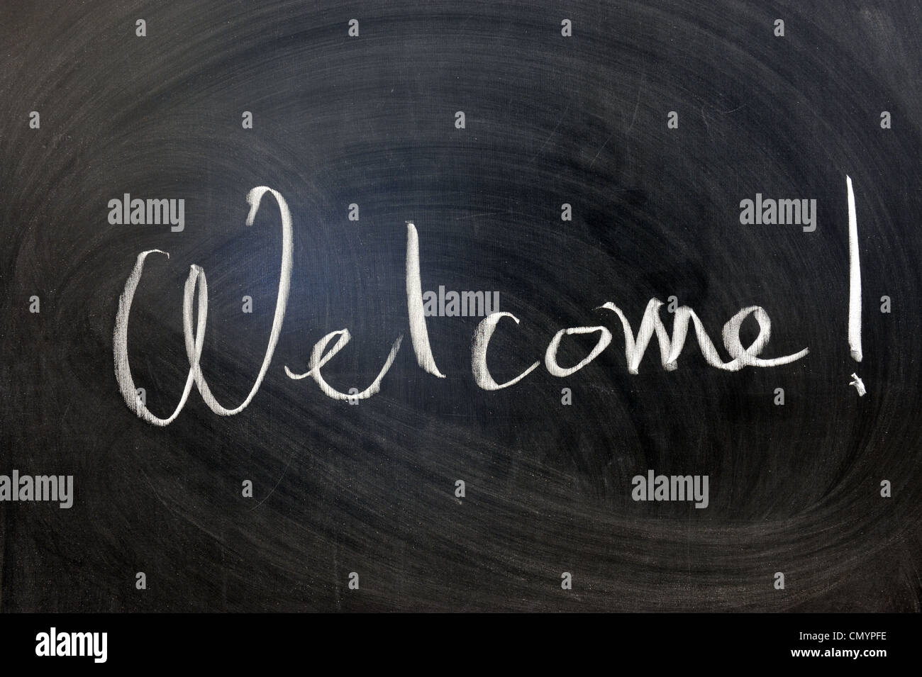 Chalk writing - Welcome word written on chalkboard - Stock Image