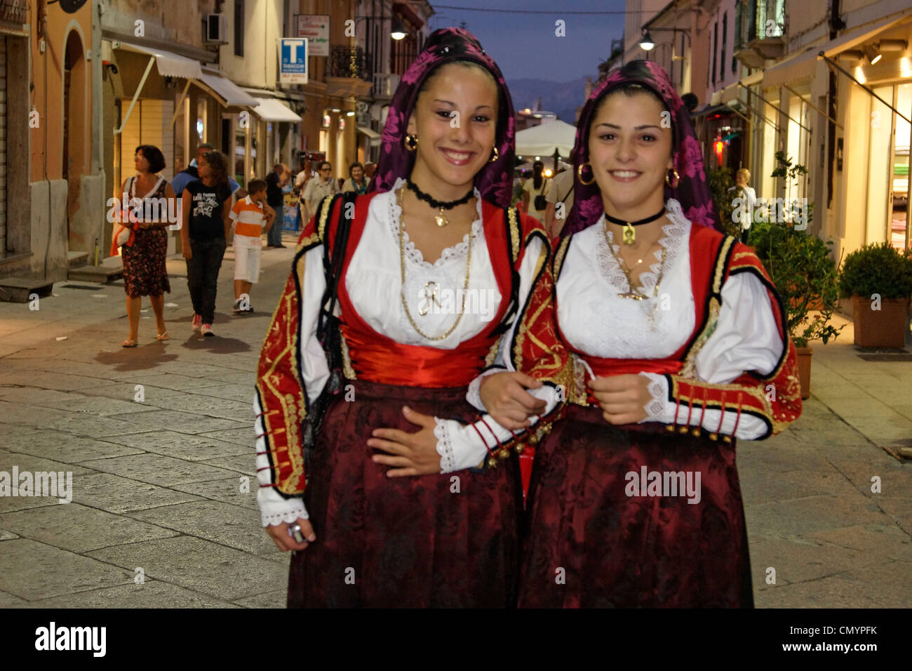 Italy Sardinia Olbia, women with traditional costumes on main street - Stock Image