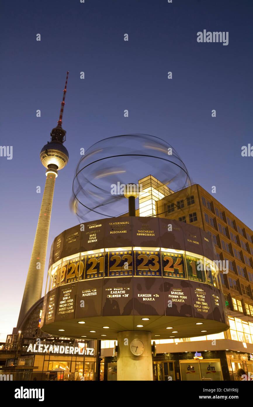 Alexanderplatz world clock TV tower at night in Berlin Stock Photo