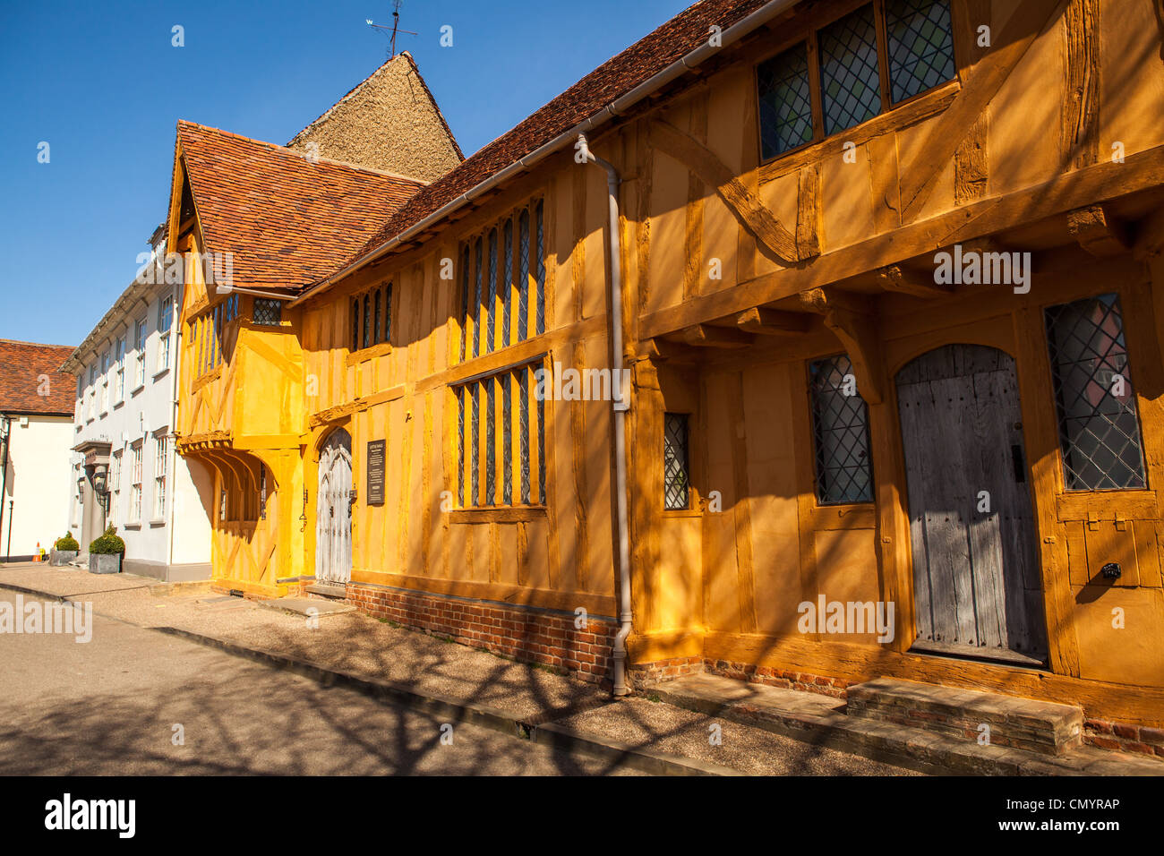 Little Hall, a mustard yellow coloured medieval Tudor building in Lavenham, Suffolk - Stock Image