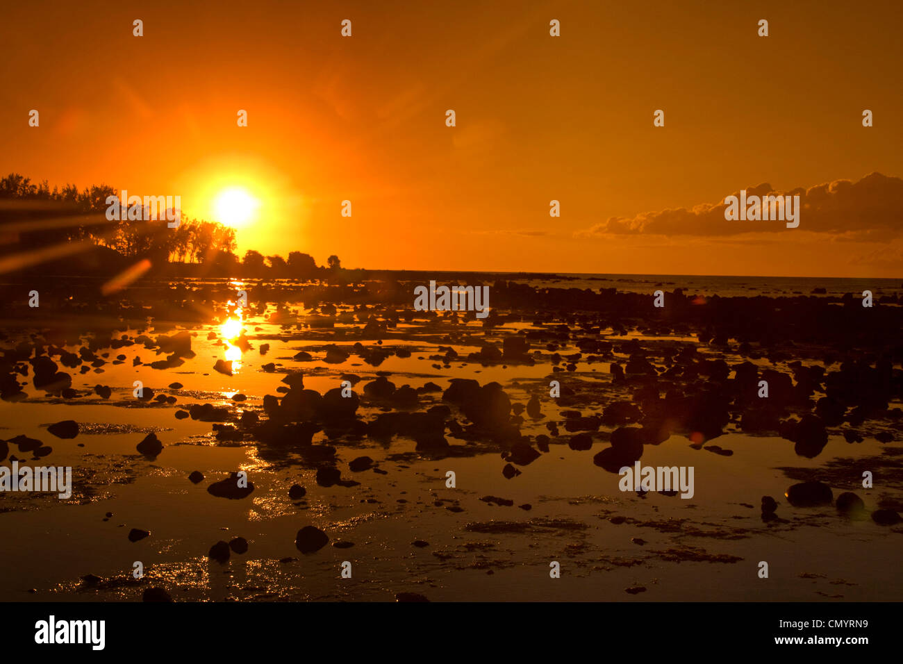 Sunset at Trou aus Biches beach at low tide, Mauritius, Africa - Stock Image