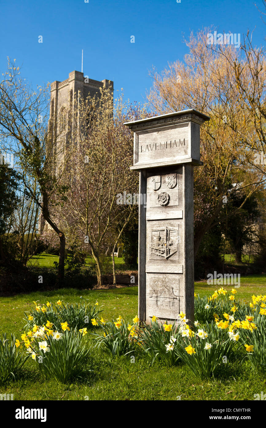 Lavenham village sign by St Peter and St Paul's Church, Lavenham, Suffolk, UK - Stock Image