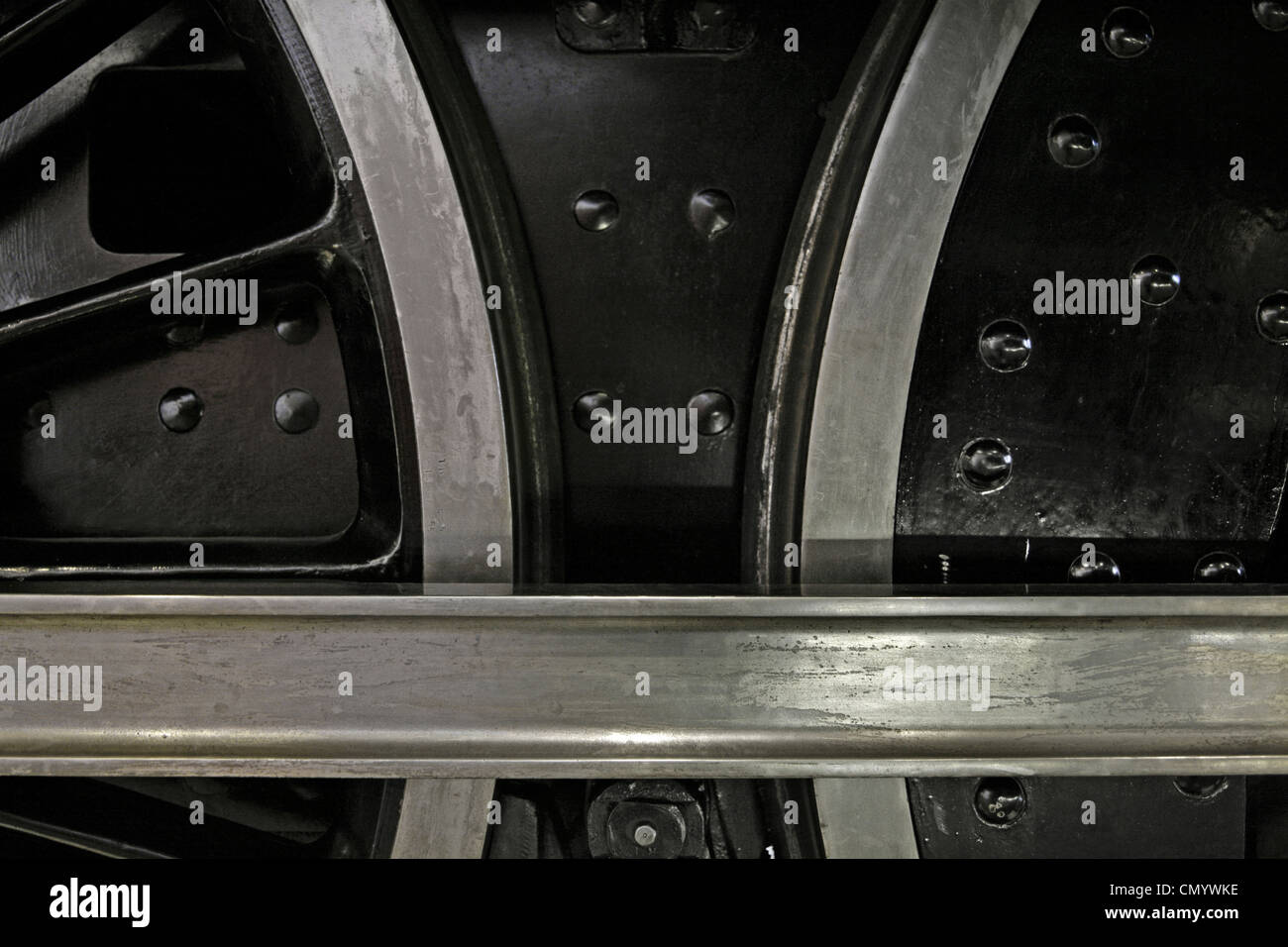 Driving wheels and connecting rod of steam locomotive. Stock Photo