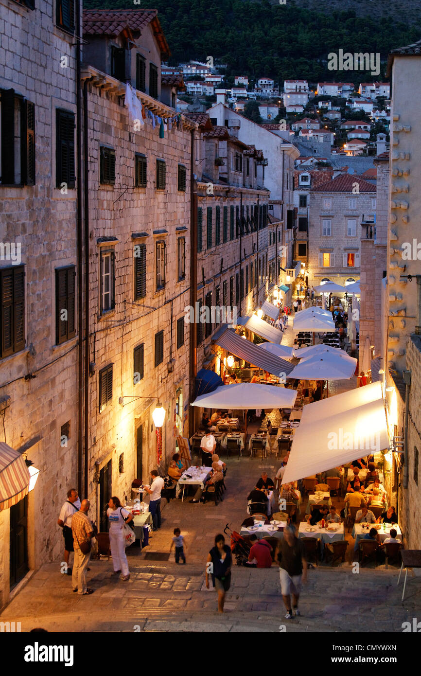 Bars and Restaurants in old city Center of Dubrovnik in the evening, Croatia - Stock Image