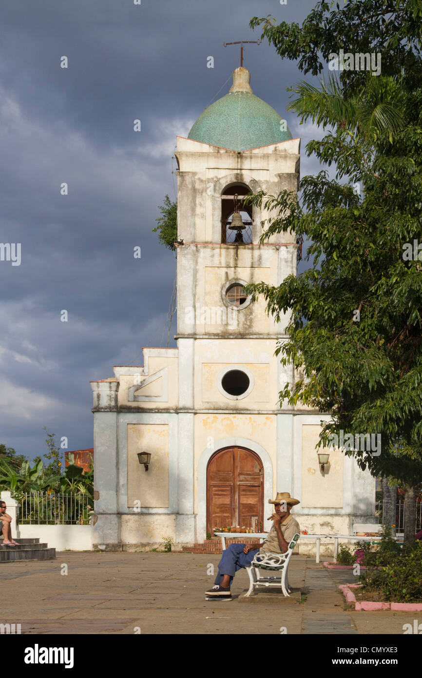 Old Man with cigar in front of village church, Vinales Valley, Province Pinar del Rio, Cuba, Greater Antilles, Antilles, - Stock Image