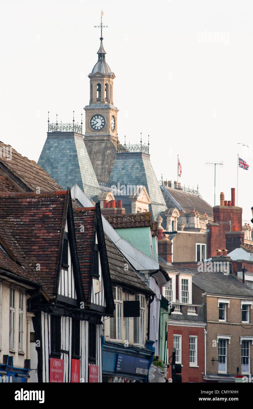 Ipswich town hall seen over shop fronts. Suffolk. England. - Stock Image