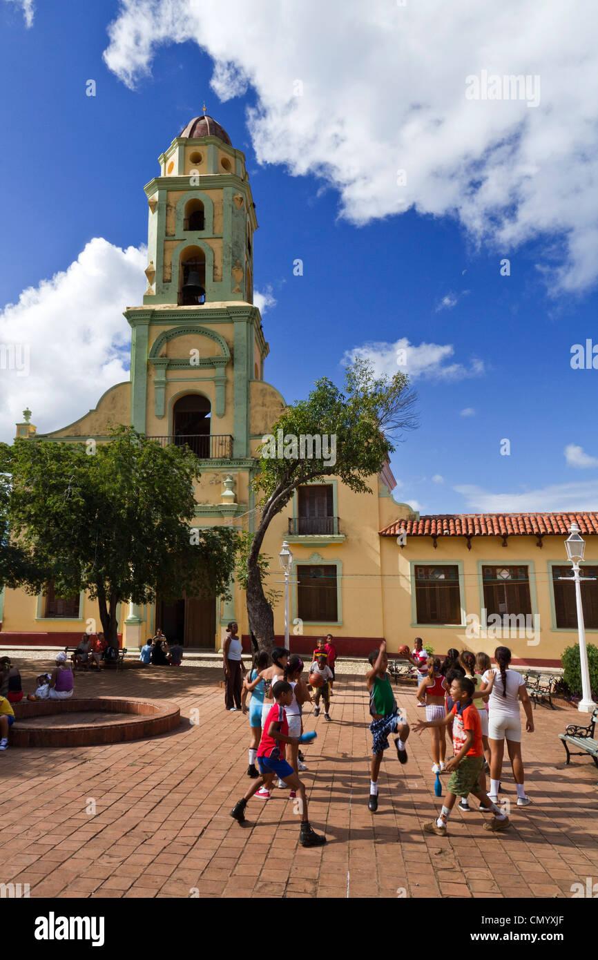 School class sports, Bell tower of Iglesia y Convento de San Francisco, Trinidad, Cuba, Greater Antilles, Antilles, Stock Photo