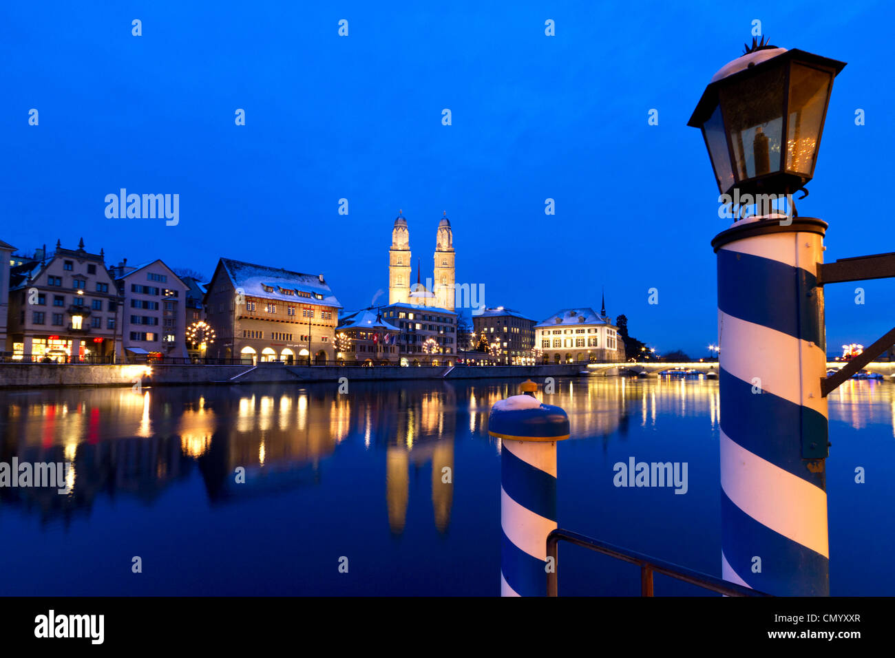 Pier at the Hotel Storchen, old town center, river Limmat at night, Limmatquai Grossmunster, Zurich, Switzerland - Stock Image