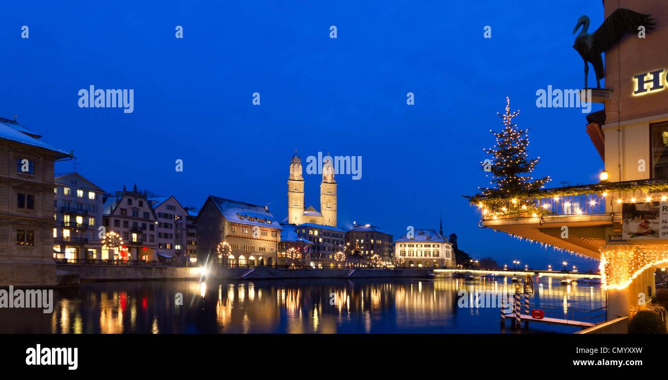 Hotel Storchen, old town center, river Limmat at night, Limmatquai Grossmunster, Zurich, Switzerland - Stock Image
