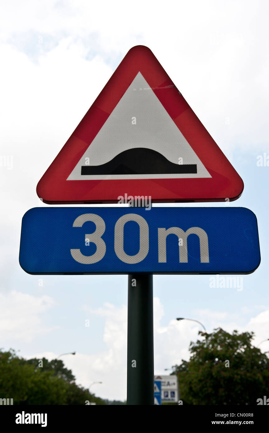 A triangular road sign in Europe. - Stock Image