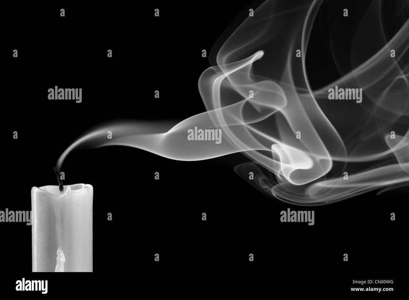 Extinguished candle with smoke (Metaphor of the death) - Stock Image