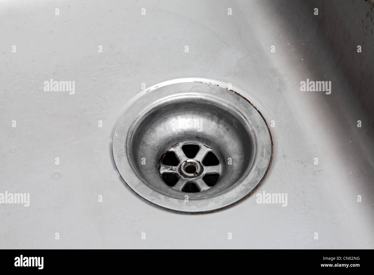 Plughole of a kitchen sink. - Stock Image