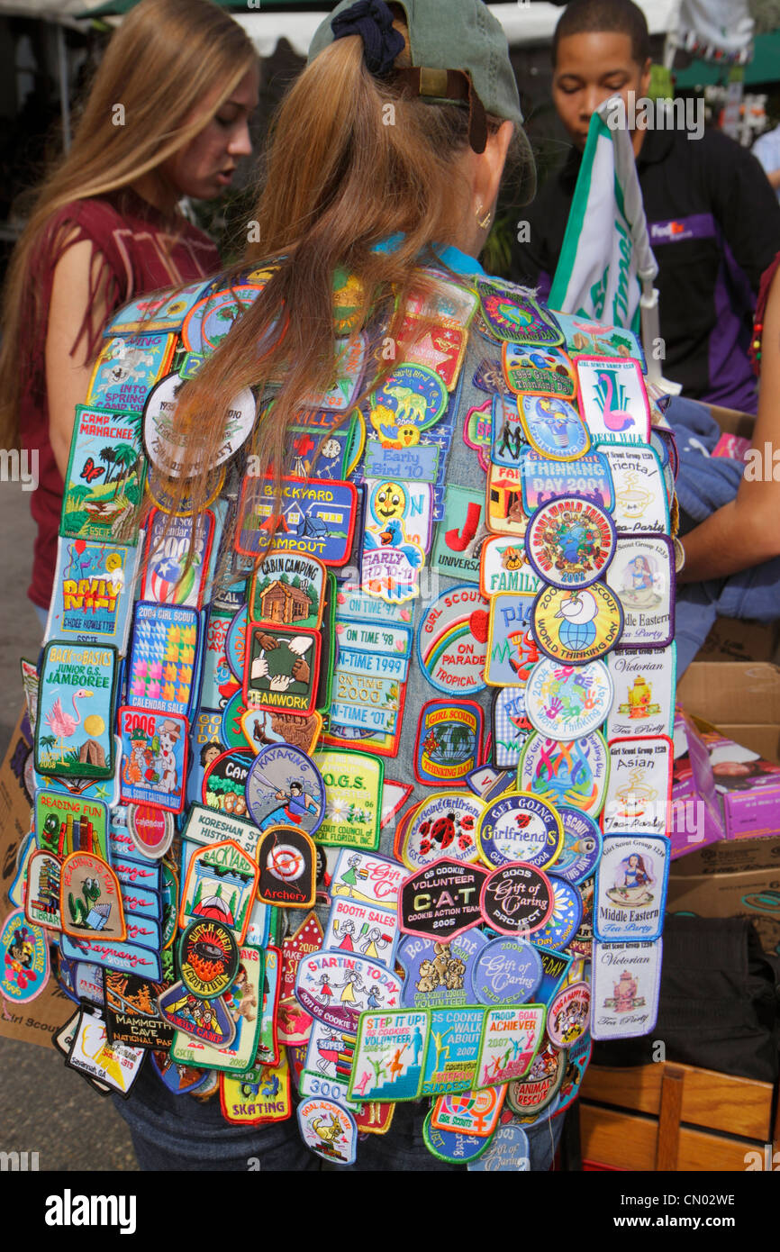 Miami Beach Florida Ocean Drive woman Girl Scout patches selling cookies - Stock Image