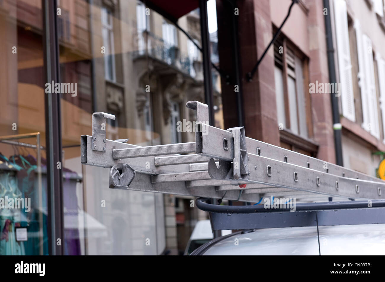 A commercial ladder on a white van. Stock Photo