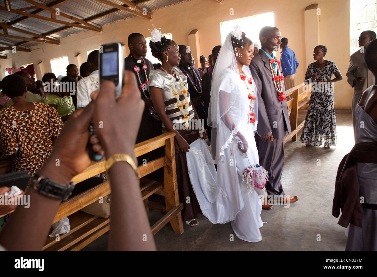 A bride and groom exit the church after their wedding ceremony in Tanzania, East Africa. Stock Photo