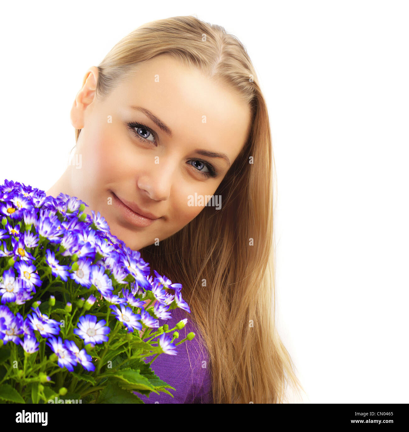 Beautiful female holding flowers, girl with bouquet of spring plant, bunch of purple cornflowers, lovely woman with Stock Photo