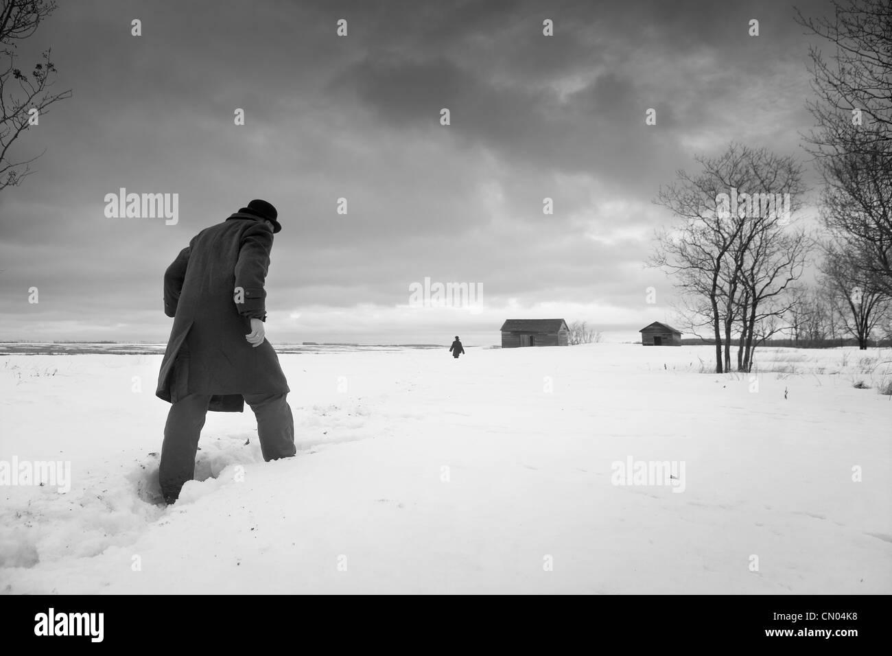 Man in Coat and Hat Walking through Snow, Winnipeg ...