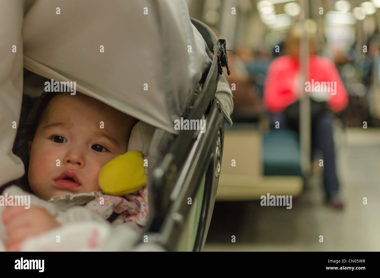 Baby in a BART train car in San Fransisco Bay area. - Stock Image