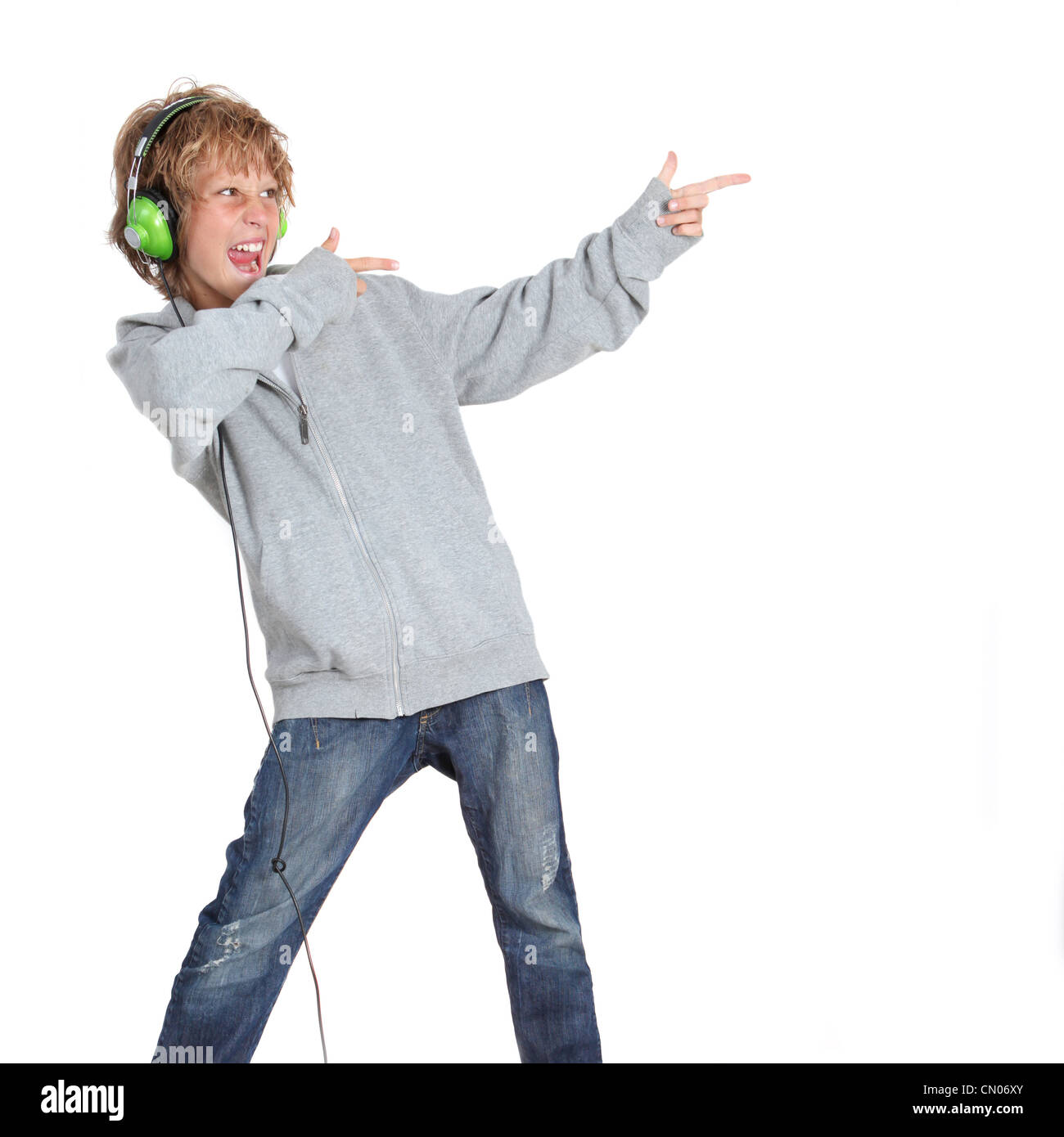 kid pointing and listening to music - Stock Image