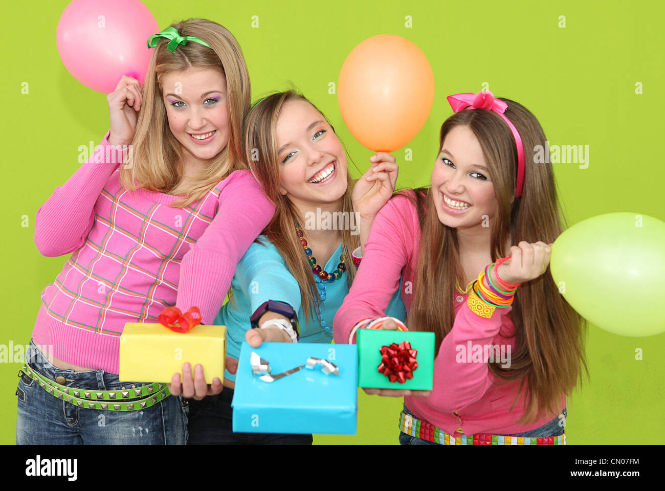 happy kids at birthday party giving wrapped gifts or presents - Stock Image