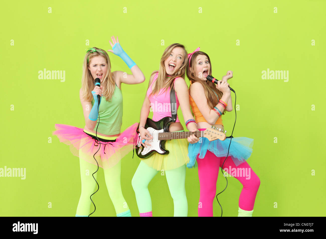 girl band, group of girls singing and playing guitar - Stock Image