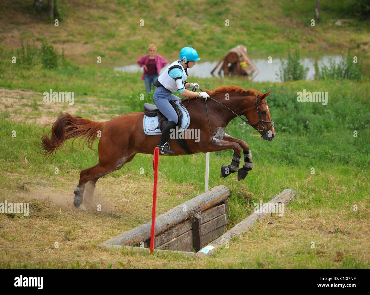 Horse and rider jumping an obstacle at a three day Eventing Competition - Stock Image