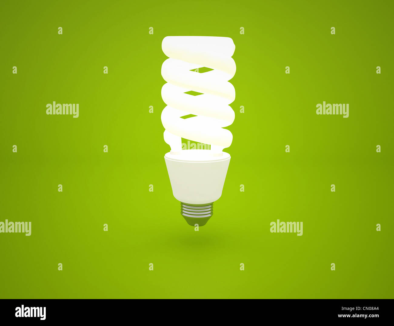 glowing Light bulb idea on green background - Stock Image