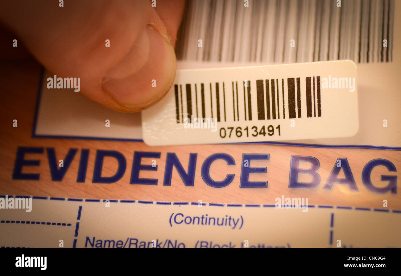 A barcode being placed on a police exhibit bag for continuity purposes - Stock Image