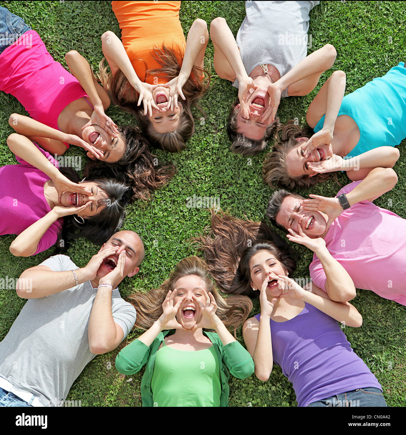group of kids or teens shouting or singing at summer camp - Stock Image