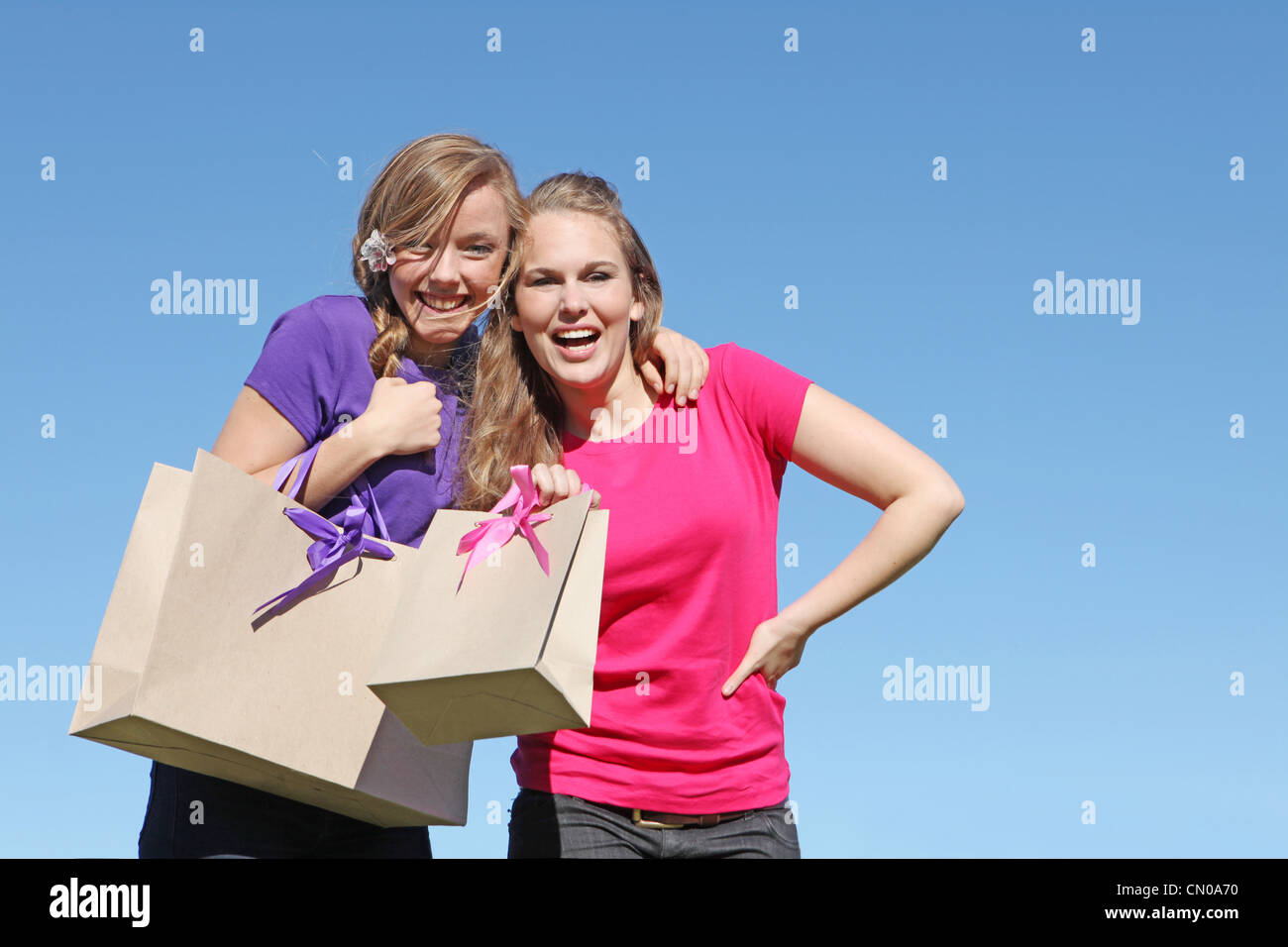 girl teenagers happy shopping with bag from recycled paper - Stock Image