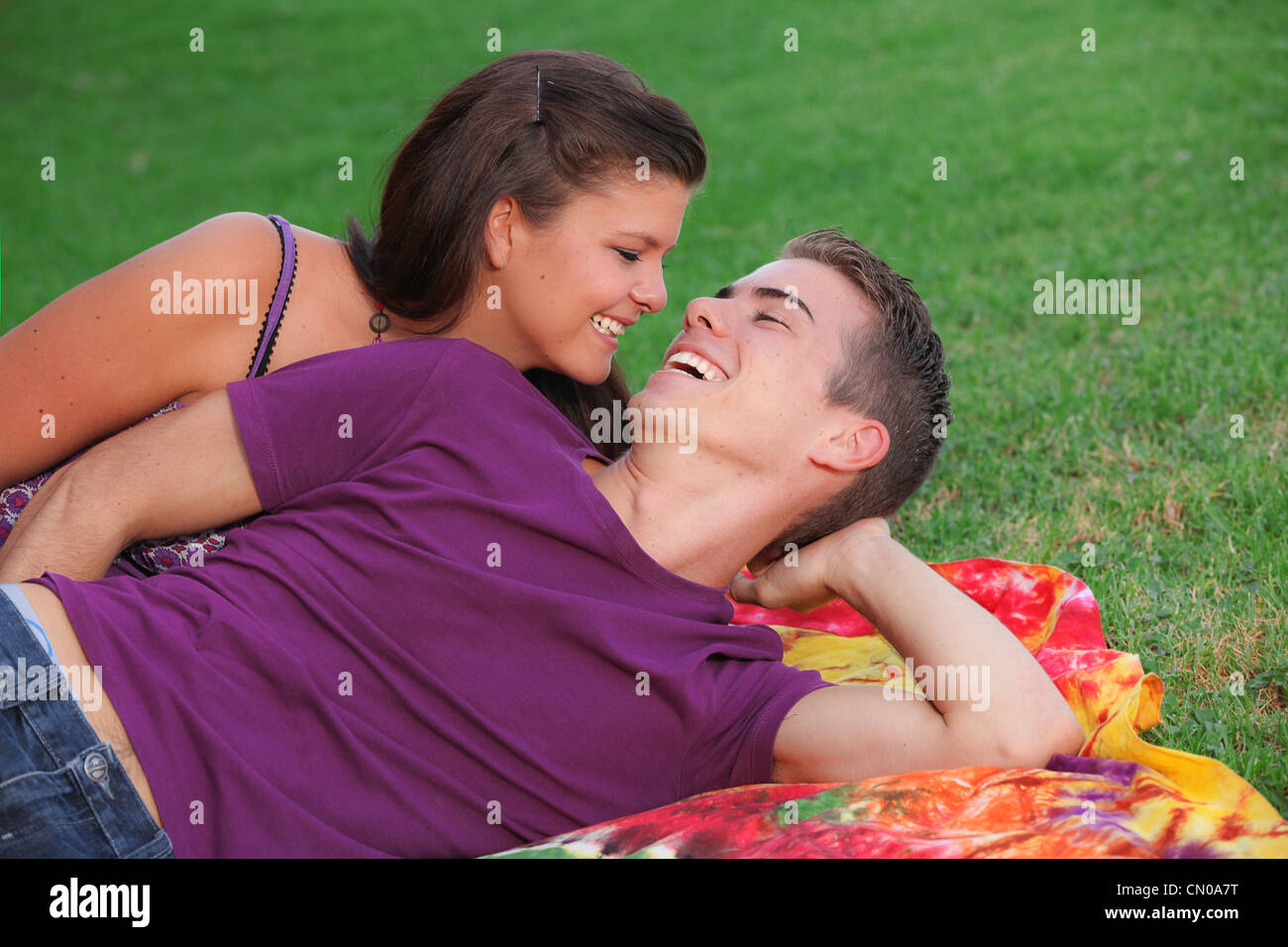 happy healhty young couple outdoors concept for fresh breath - Stock Image
