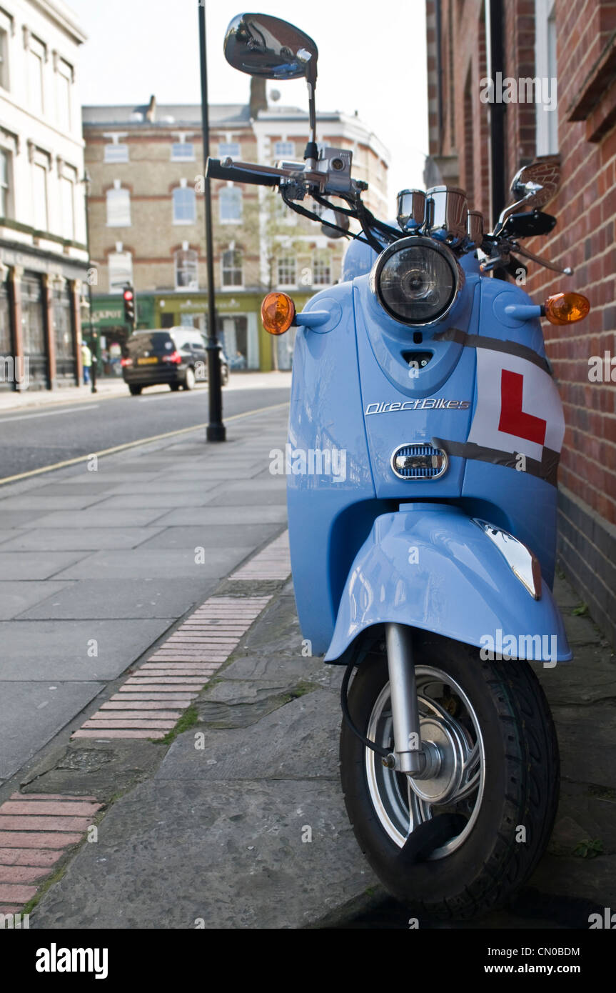 A blue Vespa styled bike Chelsea, London - Stock Image