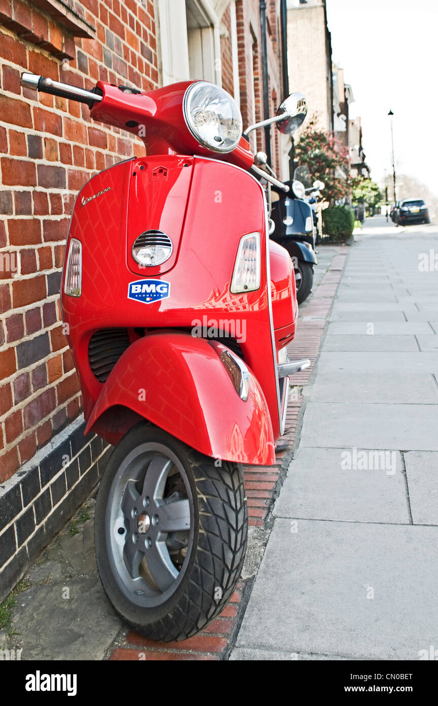 A red Vespa in Chelsea, London - Stock Image
