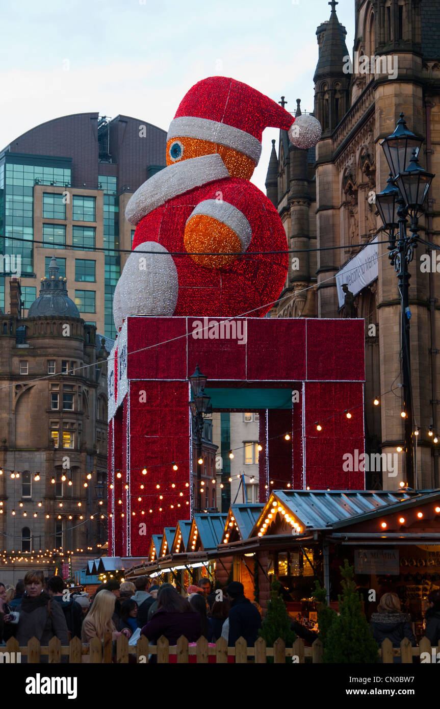 Father Christmas above the Christmas Market stalls outside the Town Hall, Albert Square, Manchester, England, UK - Stock Image