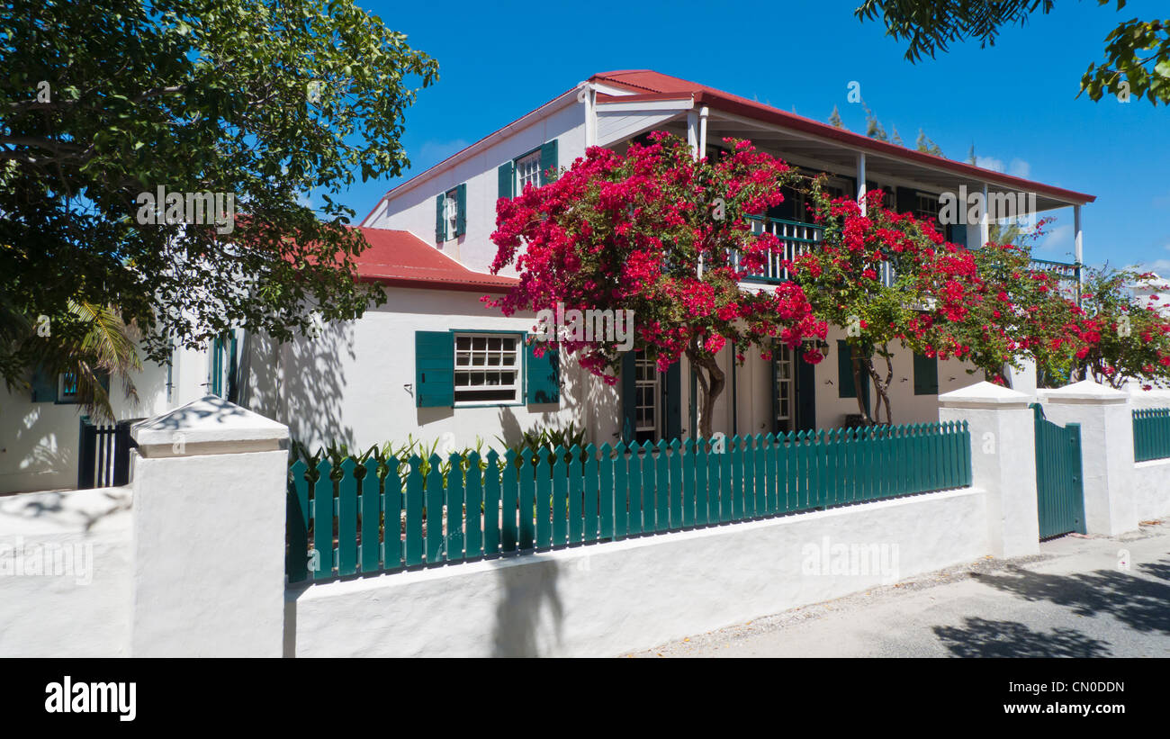 A beautiful tropical home with blooming Bougainvillea on Grand Turk island in the Caribbean on a spring day - Stock Image