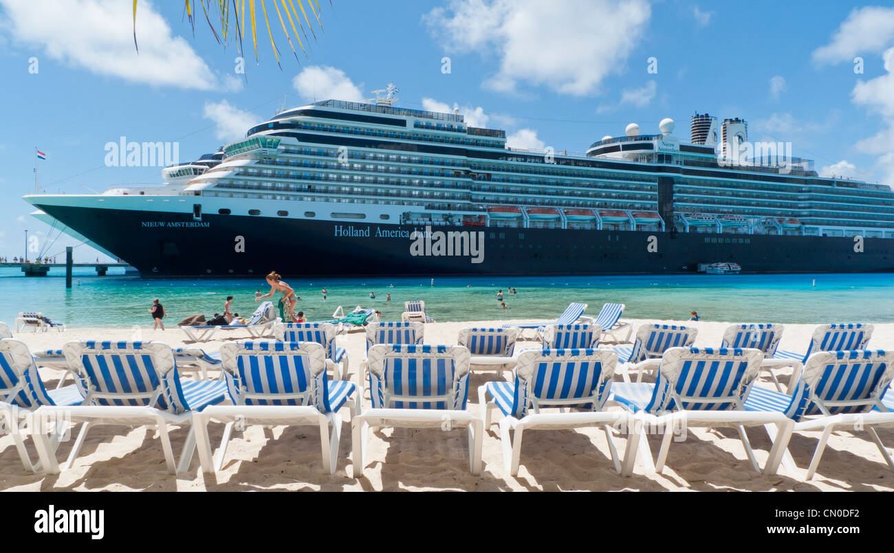 Holland America Line's Nieuw Amsterdam cruise ship at dock in Grand Turk, Caribbean while passengers enjoy the - Stock Image