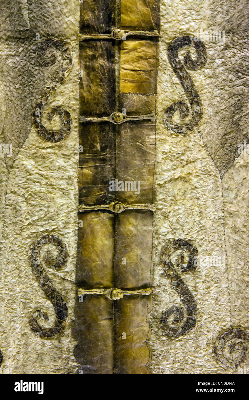 Fastening detail of an ethnic Chinese Hezhen (or Nanai) man's leather tunic. - Stock Image